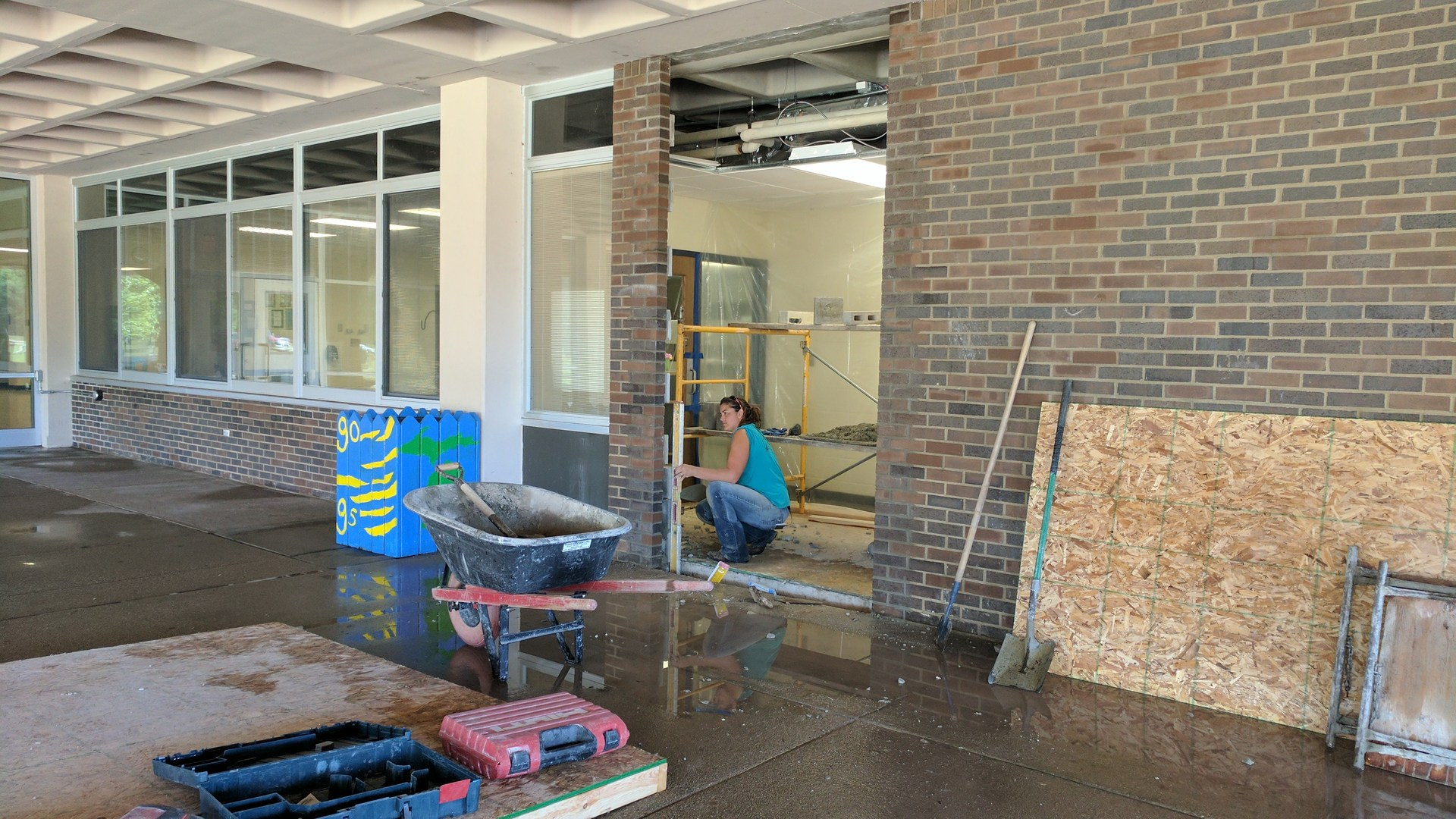 Workers create a new door for visitors to enter at Washington Street Elementary.