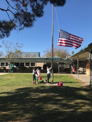 students raising the flag at bridges