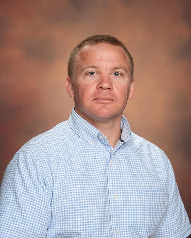Coach Phillip Dugas