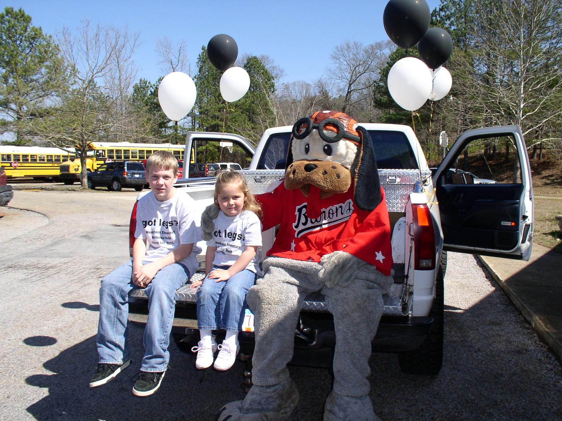 2017 Woodstock Elementary Wellness Walk students with Barons Mascot
