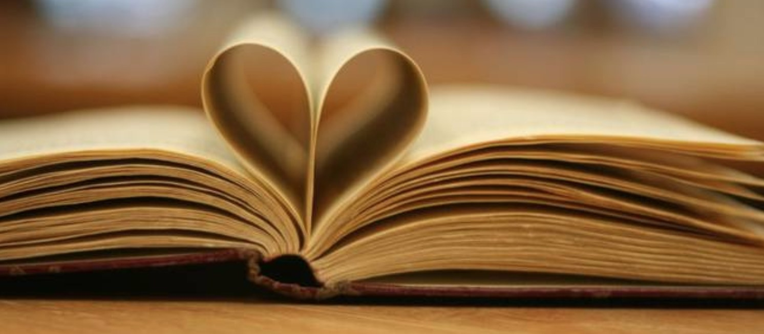 A heart made with the pages of a book.