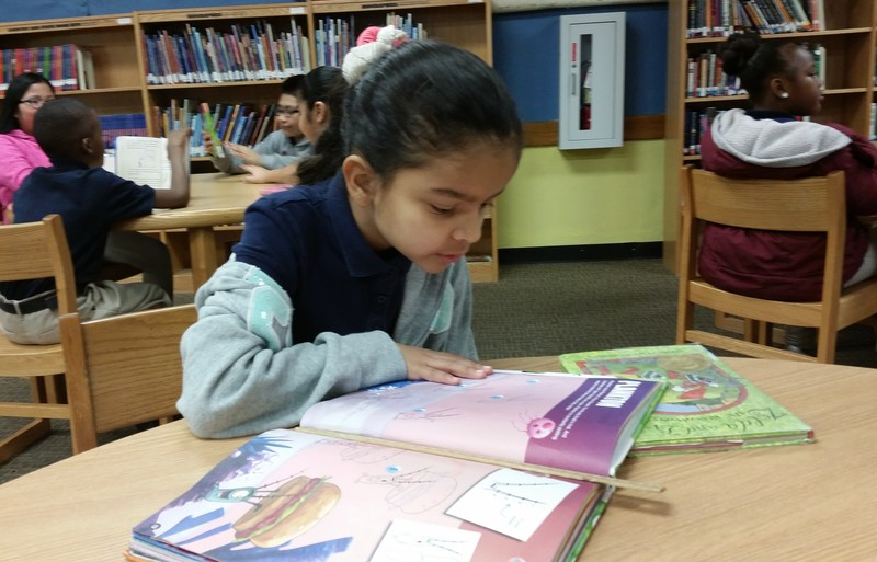 Student reading in school library