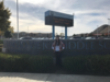 Samia Muhareb standing in front of the Rancho Viejo Middle School sign.