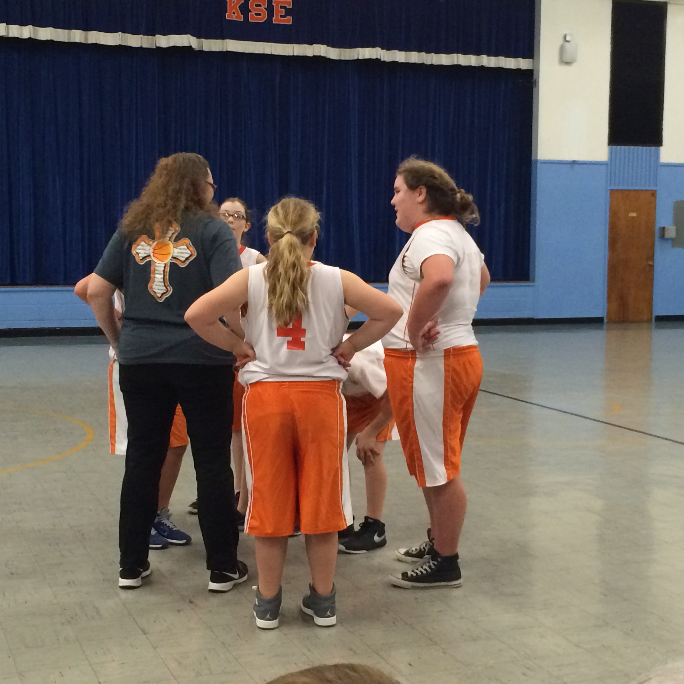 Girls huddled on court before game