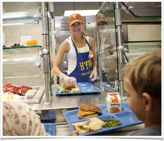 Volunteer serving lunch at Hyer