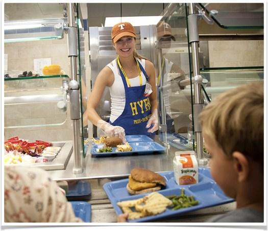 Volunteer serving lunch at Hyer