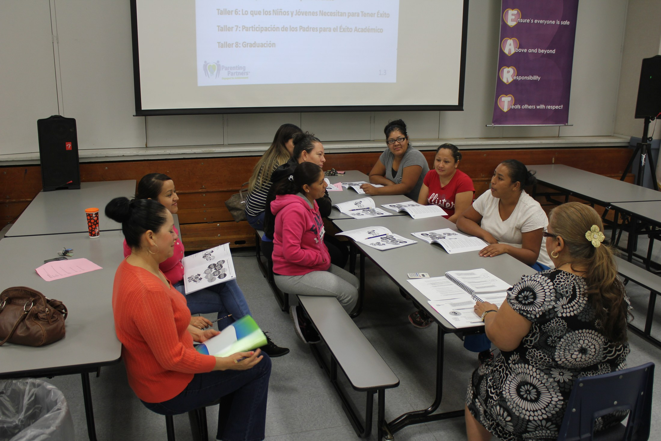Parents are involved in a discussion at a Parent Academy event.