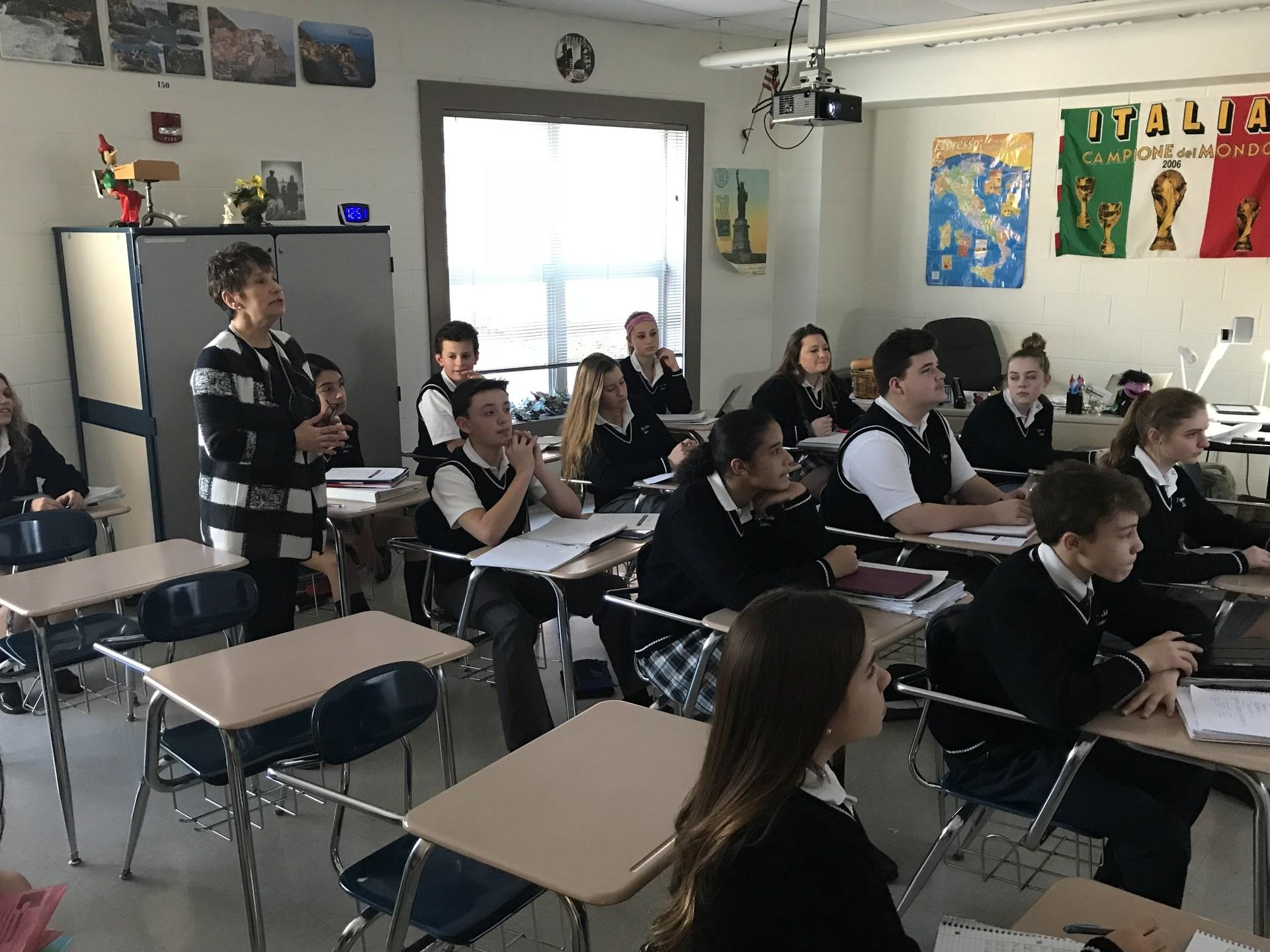 Italian teacher asking students questions