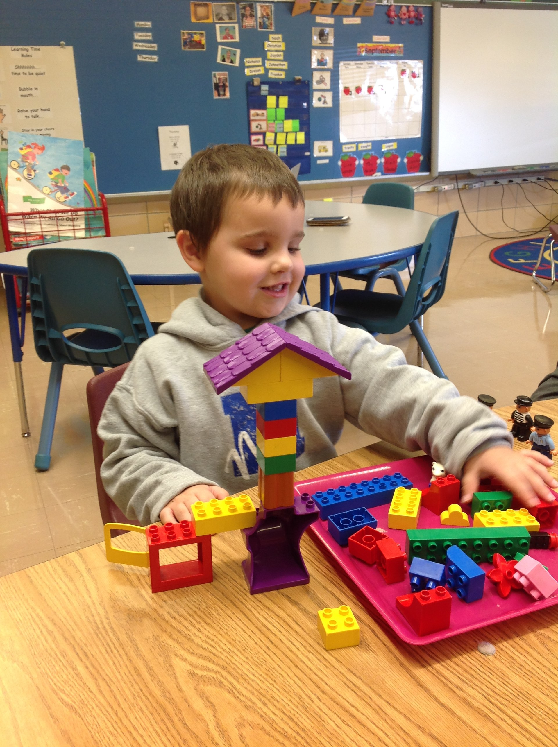 Student playing with building blocks.