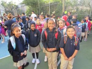 Group of Girls standing awaiting their new teacher