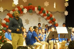 Mr. Lionel Williams introducing the West St. John Elementary Band at the St. John Parish Winter Showcase.