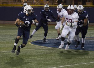 uchs football player running with the ball