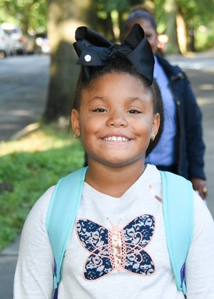 Smiling Van Cleve student arrives at school.