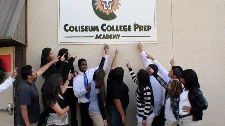 students pointing at CCPA sign on wall