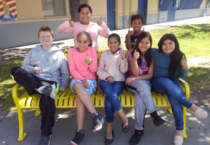 Students try out new bench.jpg