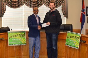 Local business donates to McComb School District Partners In Education.