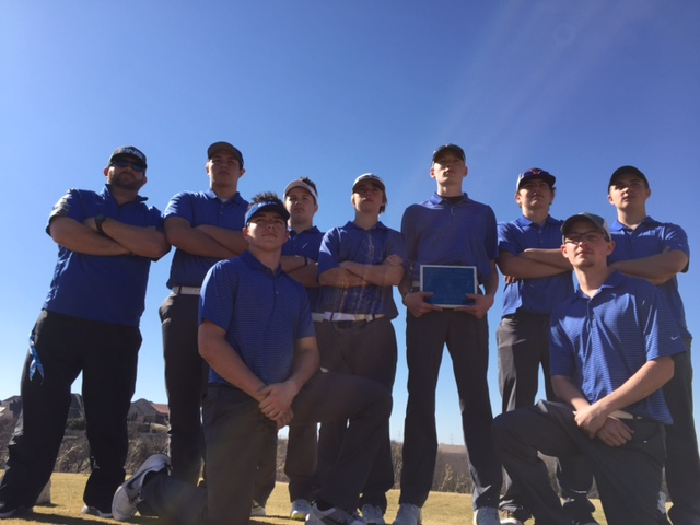 boy golf team with plaque