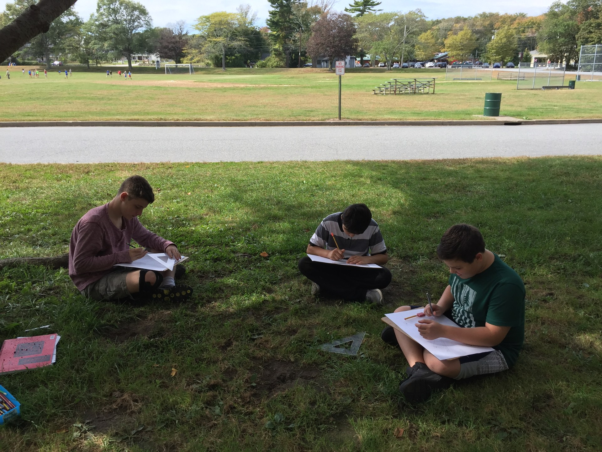 Students sketching outside