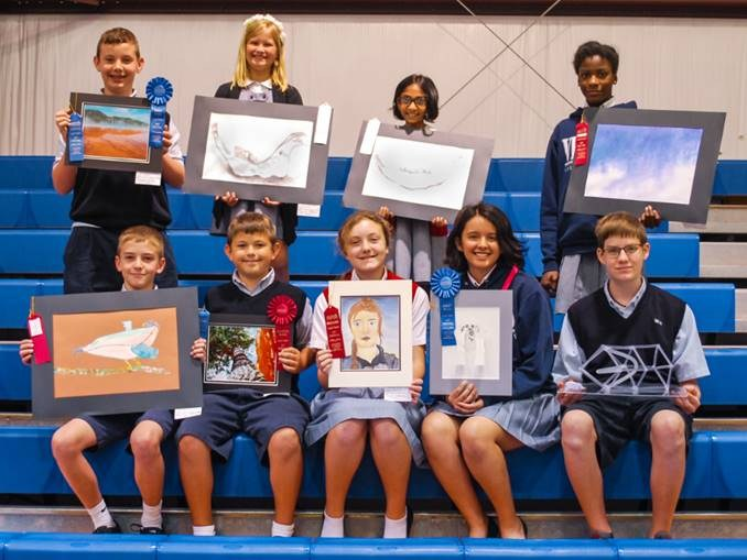 students with their artwork