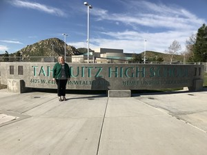 Alicia Fults in front of a Tahquitz High School sign.