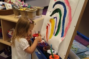 PreK Student creating artwork