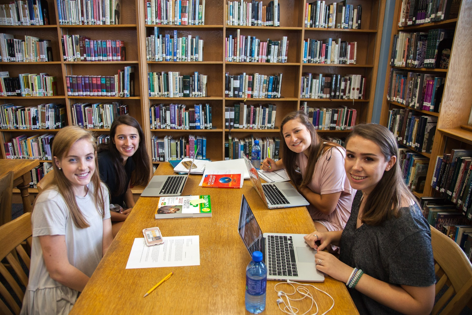 Four HPHS students work together in the school library