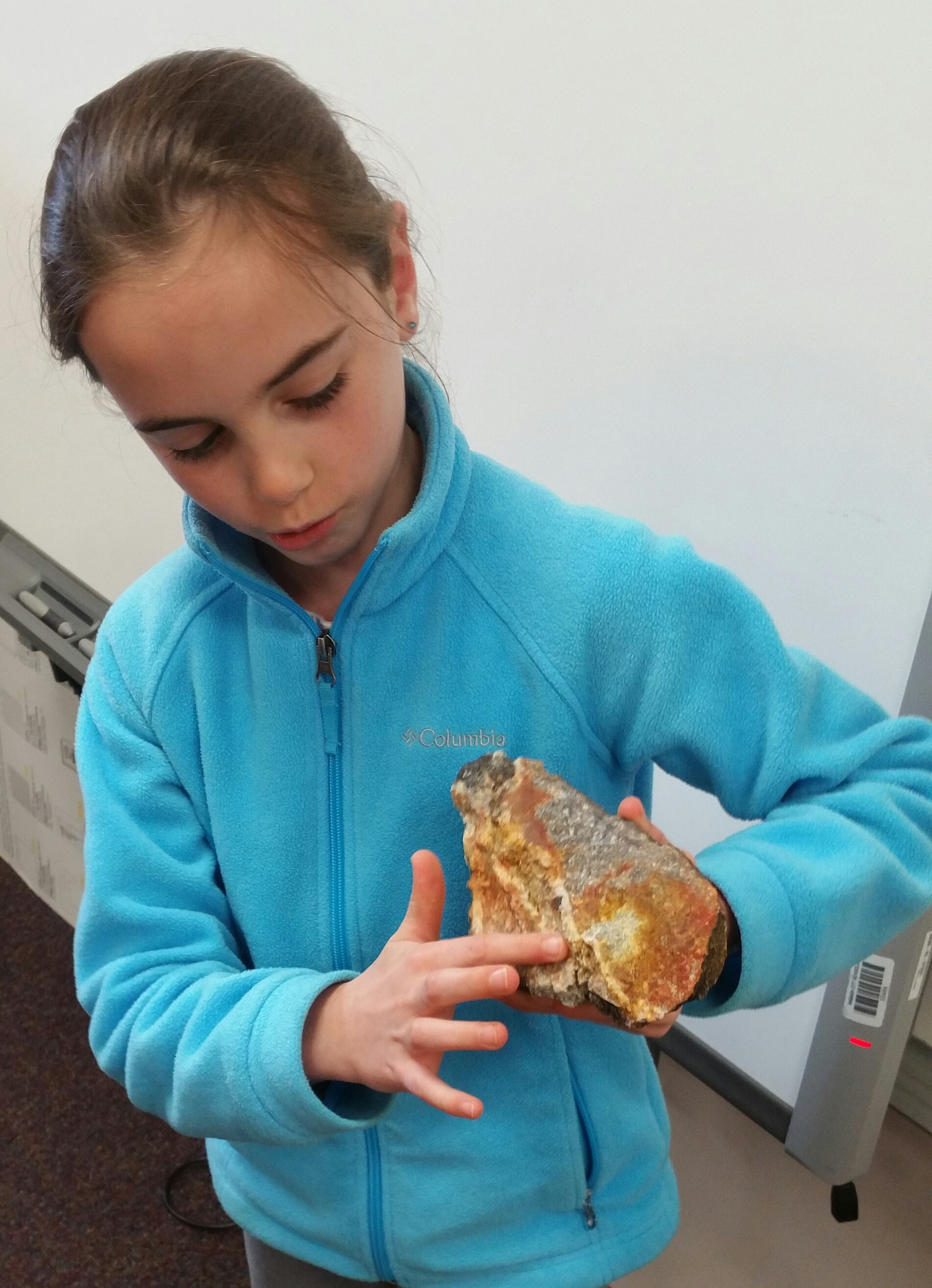 Student examining rock.