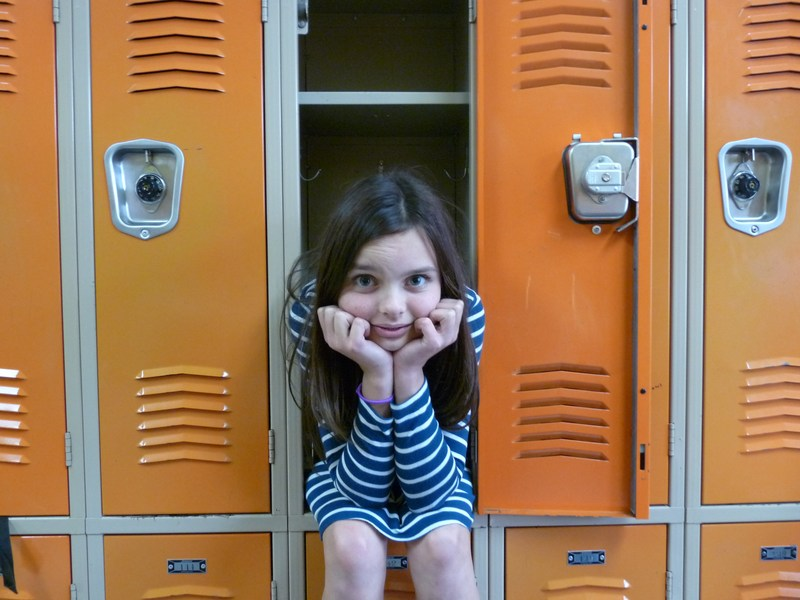 Student sitting in a locker