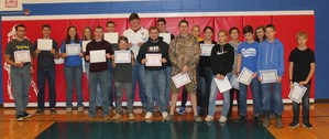 Middle school and high school students with their honor roll certificates