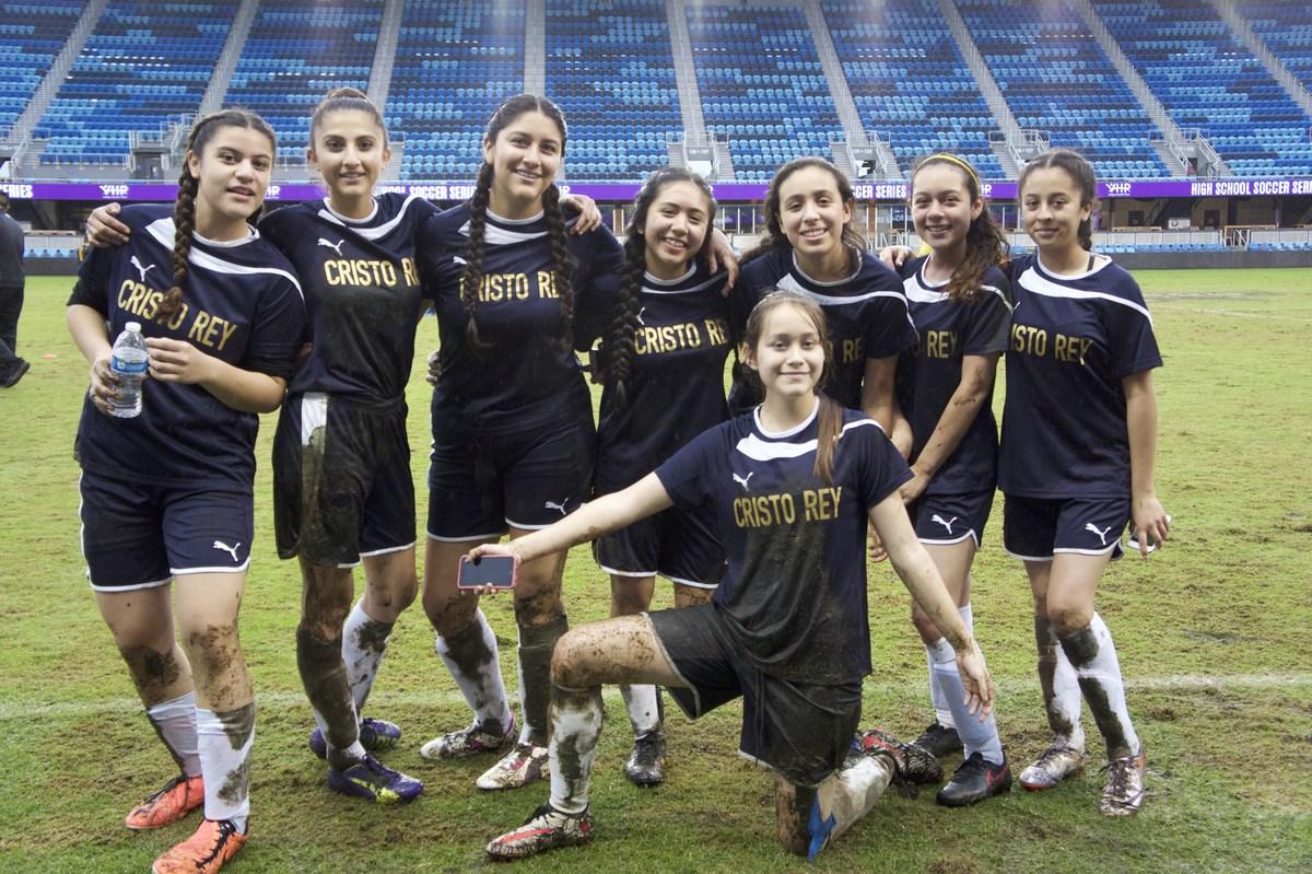 Muddy soccer girls
