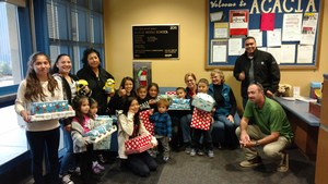 Two Acacia Middle School families with their gifts from Balfour Beatty Construction.