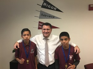 Dr. Salehi congratulating District Cross Country Champions - 6th grade:  Mauricio Gonzalez (left) & 8th grade Itzlli Garcia) &