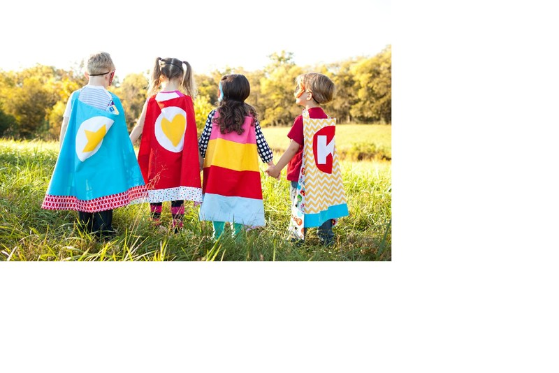 Kids dressed as superheroes.