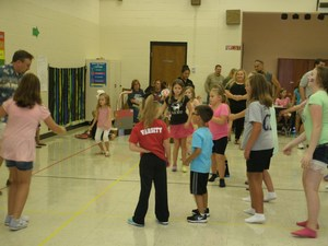 Dr. McKinney is teaching students how to do the hand jive.