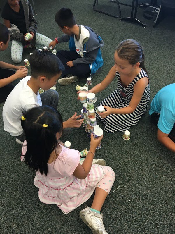 2nd and 3rd graders participate in a STEAM challenge.
