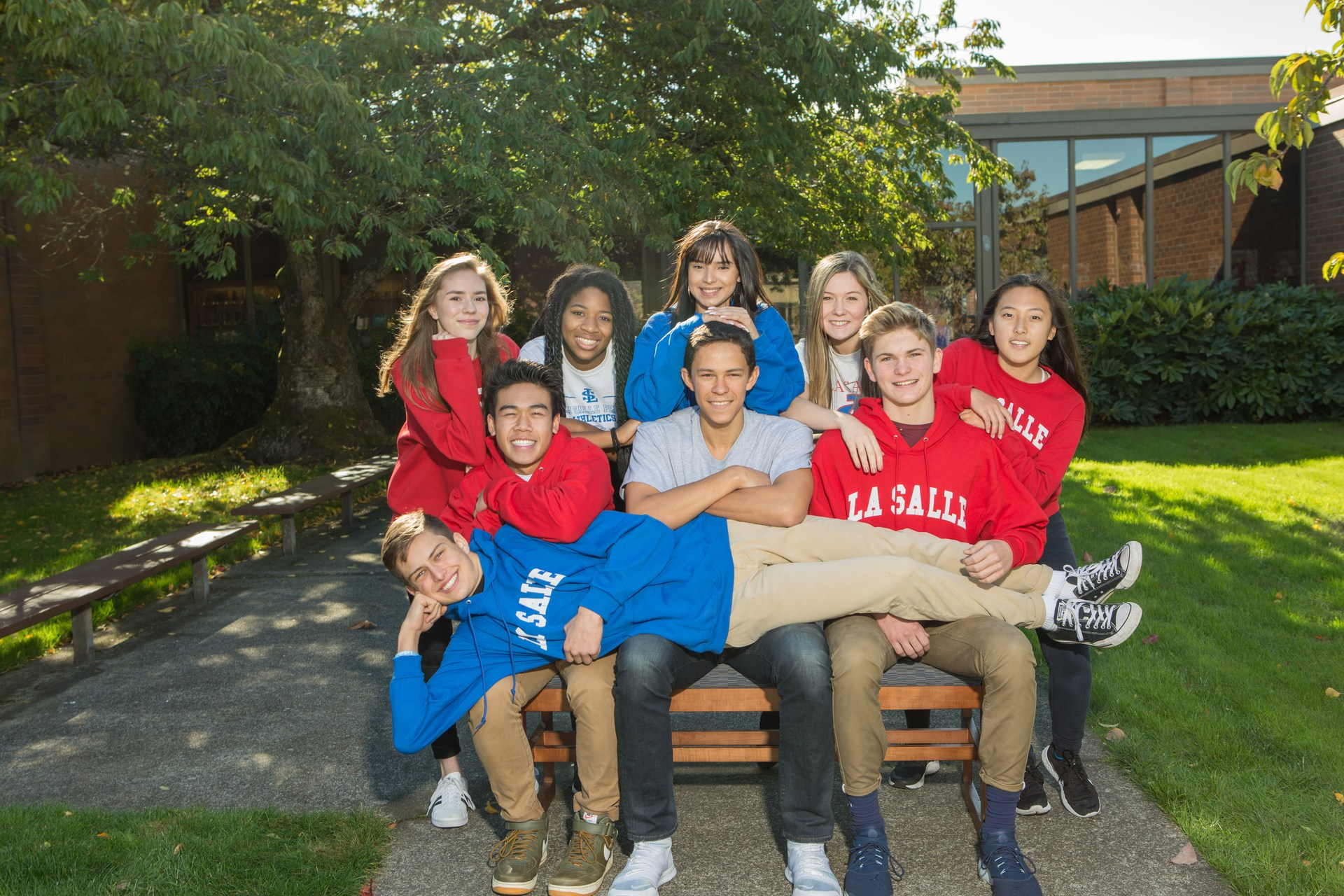 Students sitting on bench.