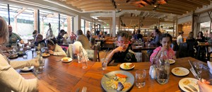 Wide angle view of the kids in the resturant eating