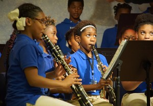 Makhia Jasmine, Jayce Farnell, Amina Blackman and Serena Johnson in the front row on clarinets. Londyn Nathan and Danaisha Narcisse second row on saxophones. RaQuan Roberson and Alex Gale in back row on drums.