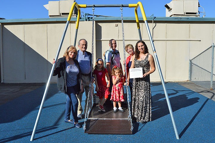 George Key dedicates new wheelchair swing in memory of student Thumbnail Image