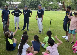 Group of campers getting instructions on how to play