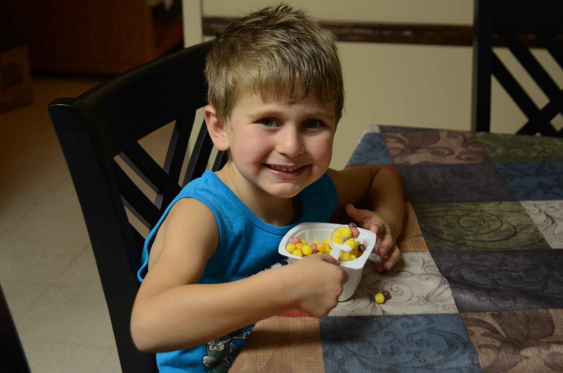 Happy boy eat snack