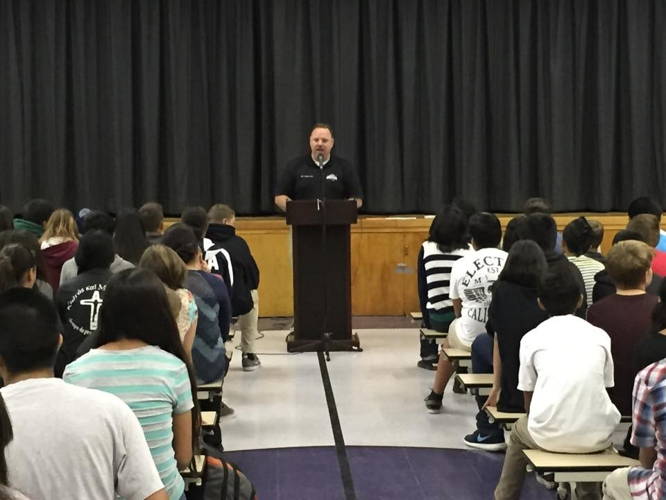 Principal Mayernik speaking at an assembly