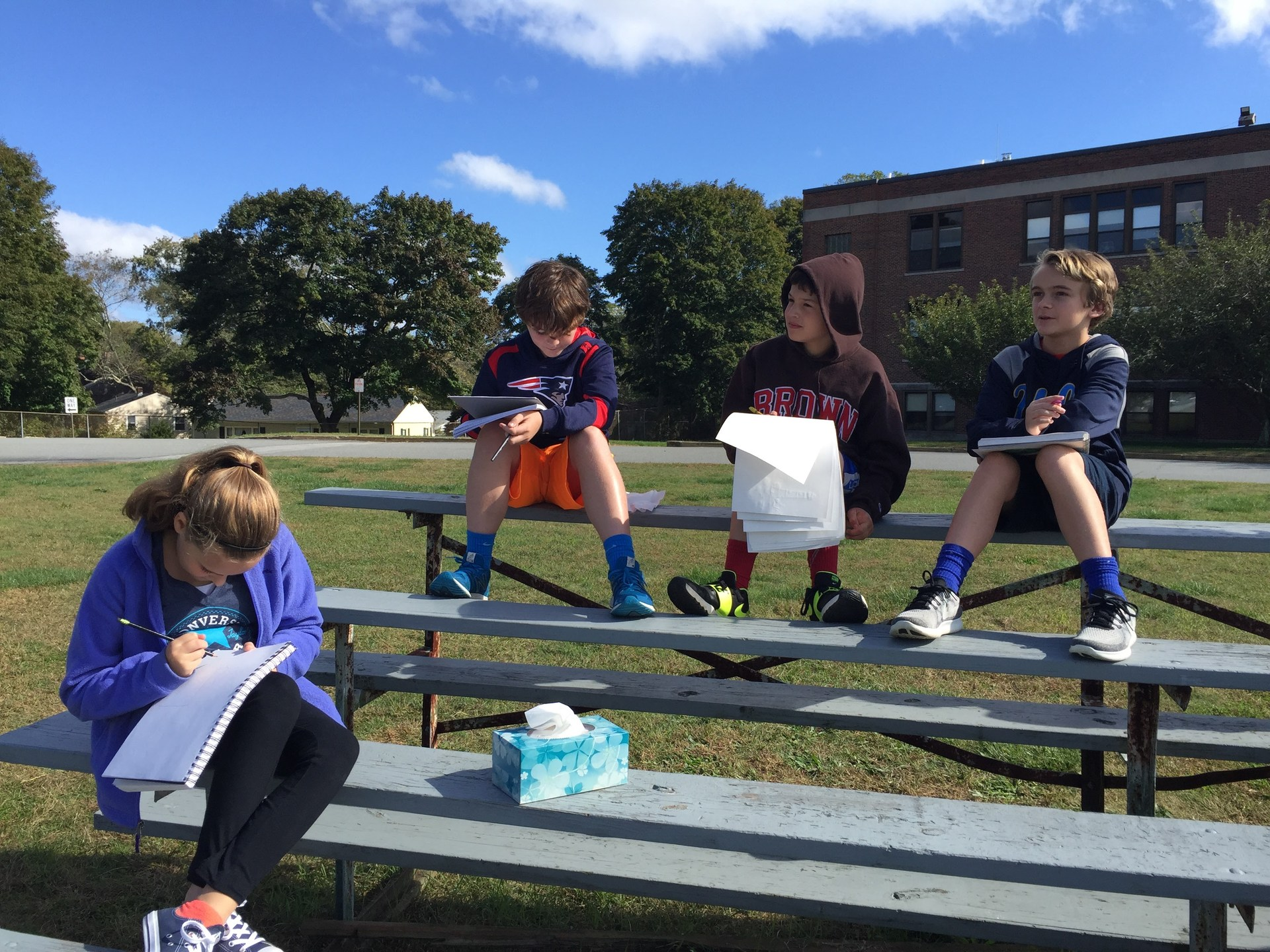 6th graders sketching outside