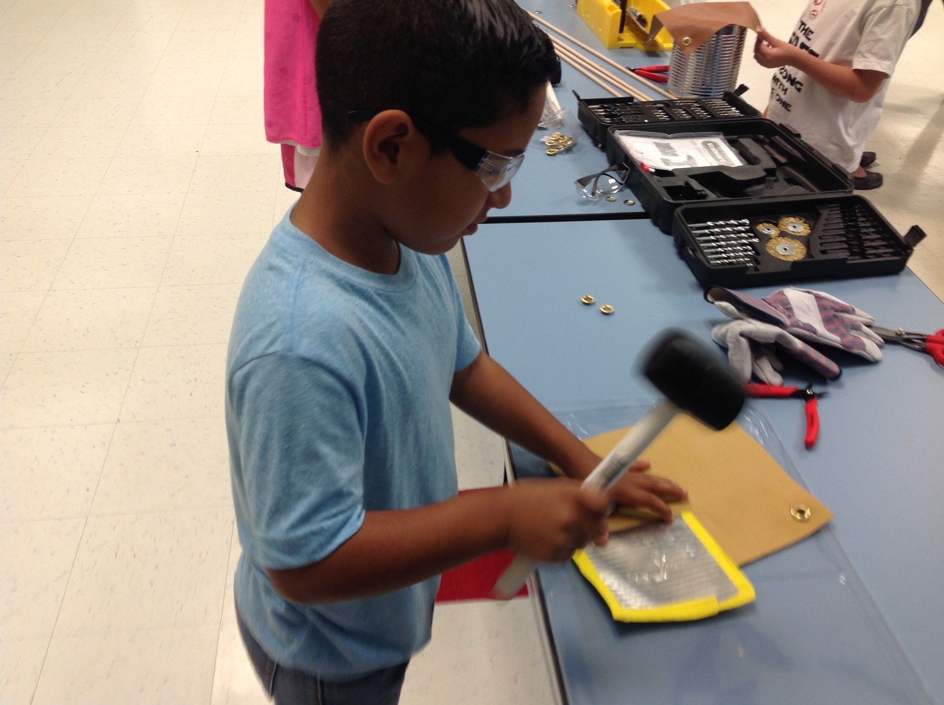 Student creating a drum.
