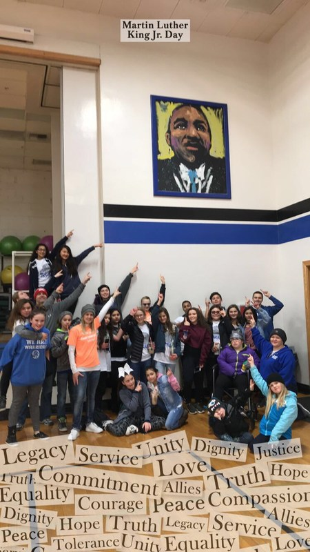 Frontier Students around a painting of Martin Luther King