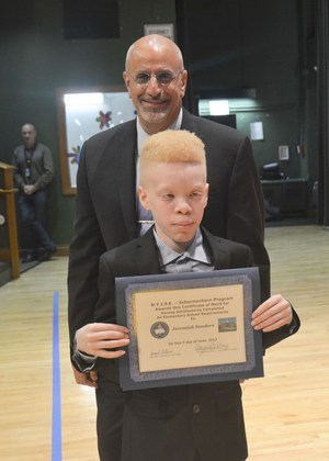 Student with his diploma and Mr. Catavero