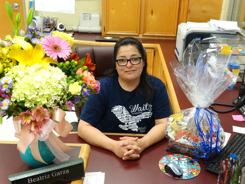 staff member of the year Bea Garza at her desk