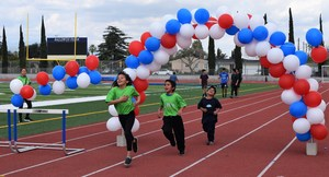 Tracy and Vineland Elementary students from kindergarten through sixth grade dash to complete the last mile of a 26.2-mile marathon as part of Rod Dixon's Kids Marathon Run Club. Since October, students have been running in weekly stages to finish the marathon with March 23 marking the final mile.