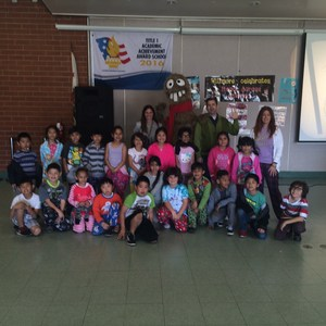 Mrs. Cordova's class taking a picture with Parker Jacobs and Tooba