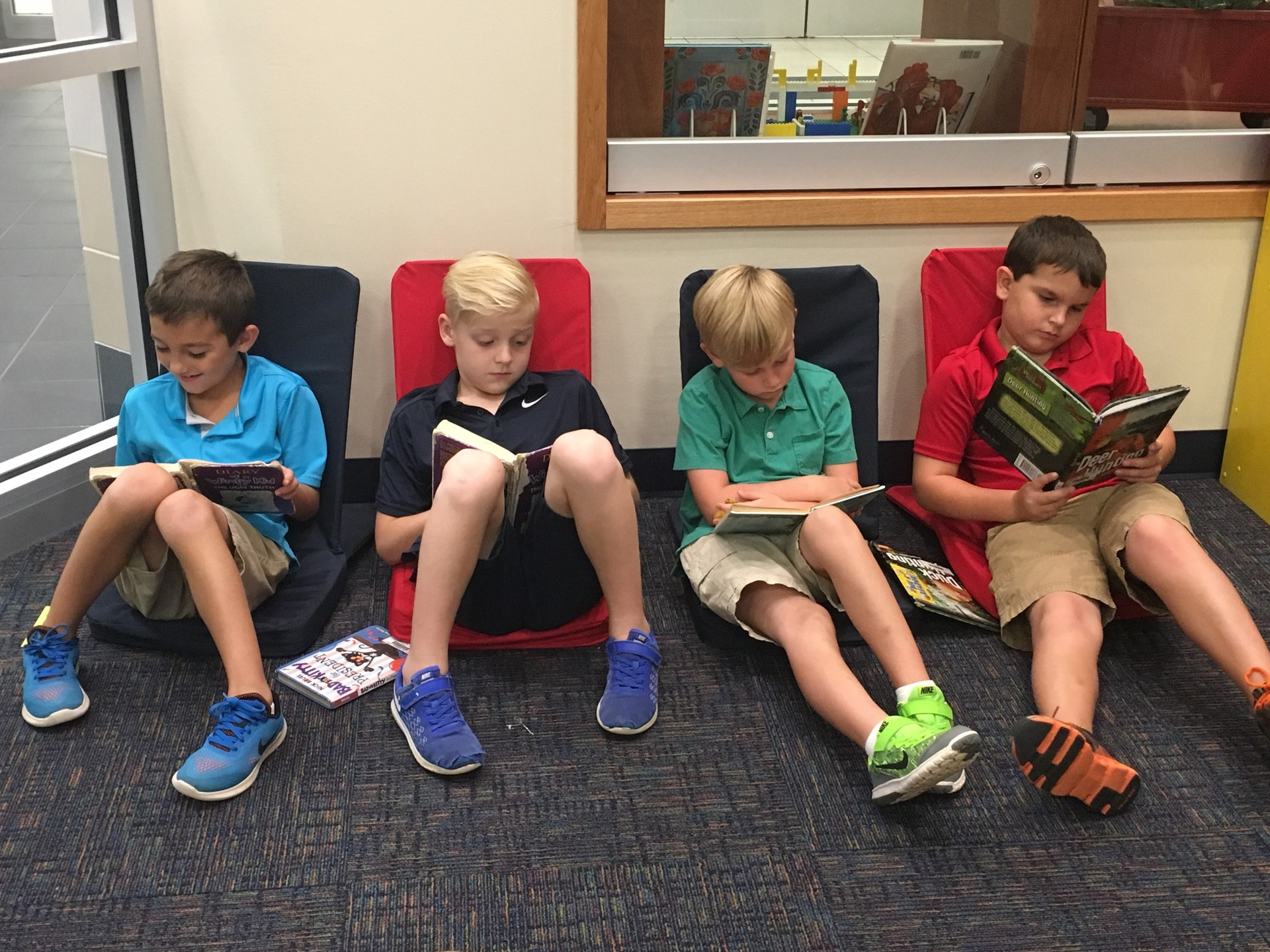 Reading taking place at the library.
